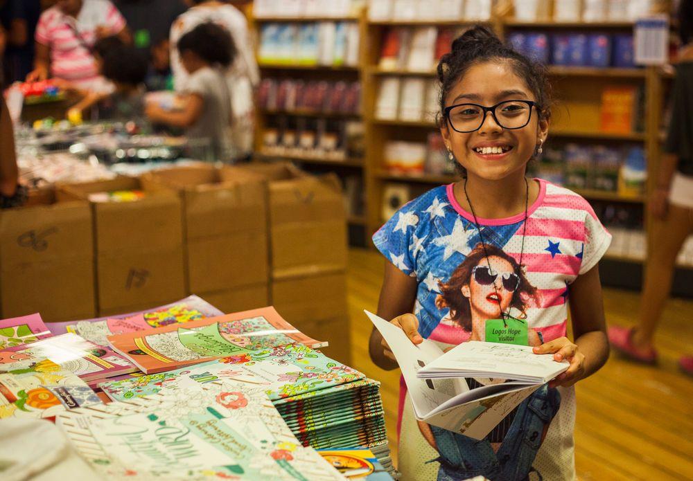 Guatemala: Puerto Quetzal, Guatemala :: A young girl browses through the bookfair on board Logos Hope. More Info