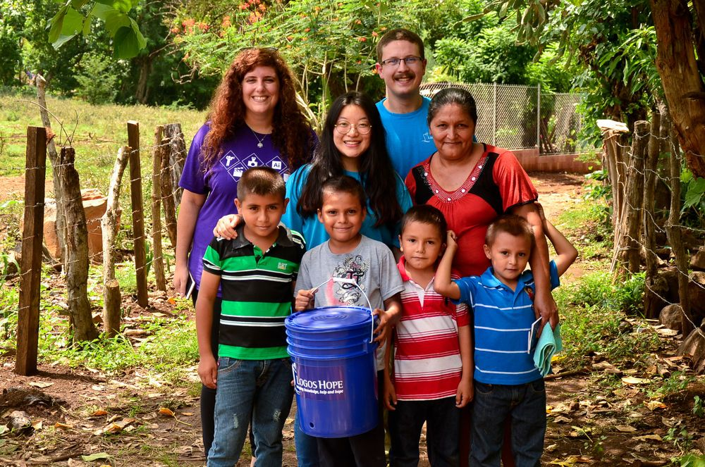 El Salvador: Acajutla, El Salvador :: Prisca-Sarah Baligand (France), HyeMin Song (South Korea) and Simon Hutegger (Austria) donate a water purifier to a rural community. More Info