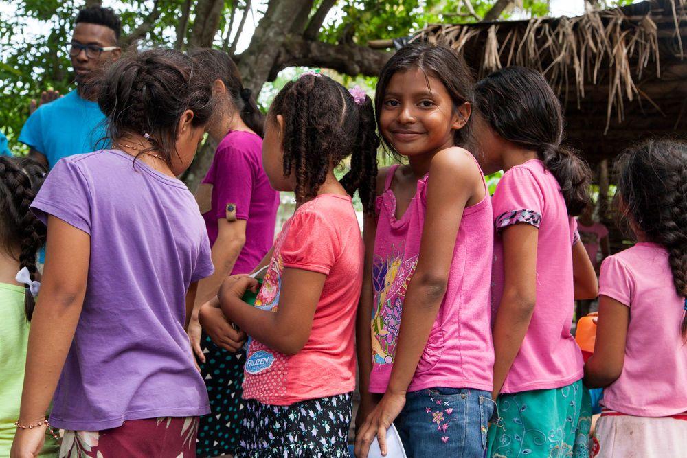 El Salvador: Acajutla, El Salvador :: A girl smiles in line as she waits for her lunch. More Info