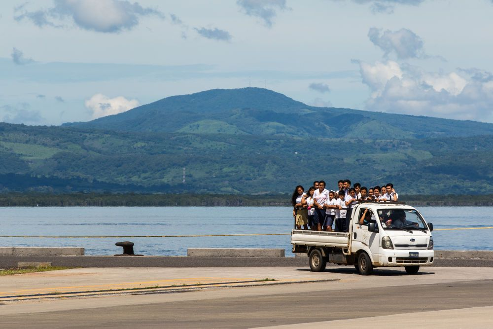 El Salvador: La Union, El Salvador :: Schoolchildren arrive by truck to visit Logos Hope in port. More Info