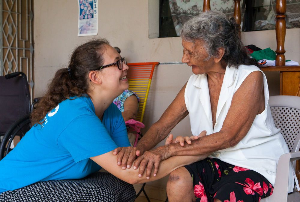 El Salvador: La Union, El Salvador :: Lara Widmer (Switzerland) connects with an elderly woman. More Info