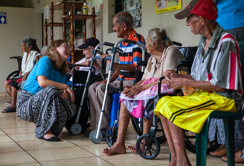 El Salvador: La Union, El Salvador :: Janina Betz (Germany) talks with an elderly man. More Info