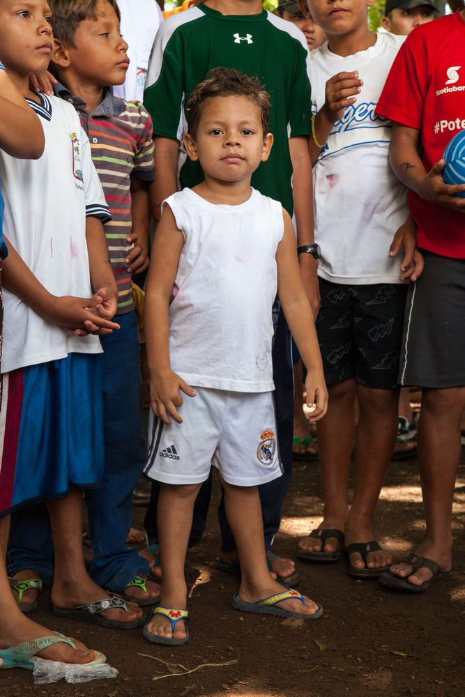 El Salvador: La Union, El Salvador :: A young boy, displaced from his home due to flooding, lives with his family in a community centre until the water subsides. More Info