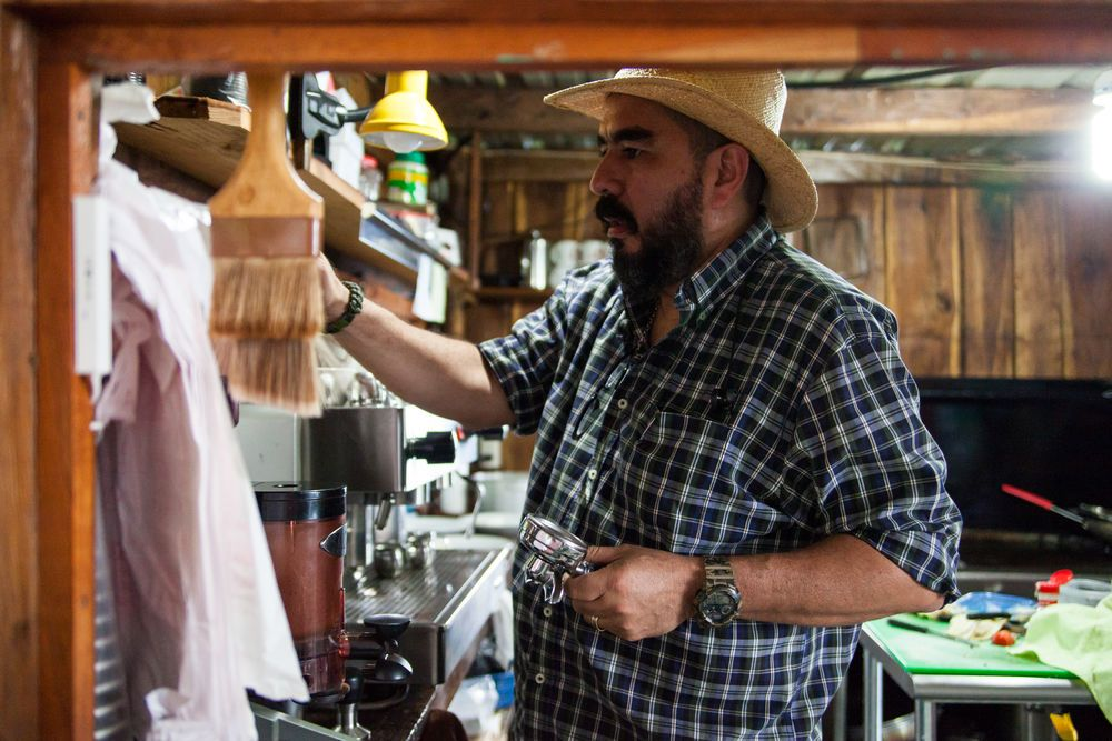 El Salvador: La Union, El Salvador :: The owner of a traditional restaurant and café makes coffee from beans grown and roasted in El Salvador. More Info