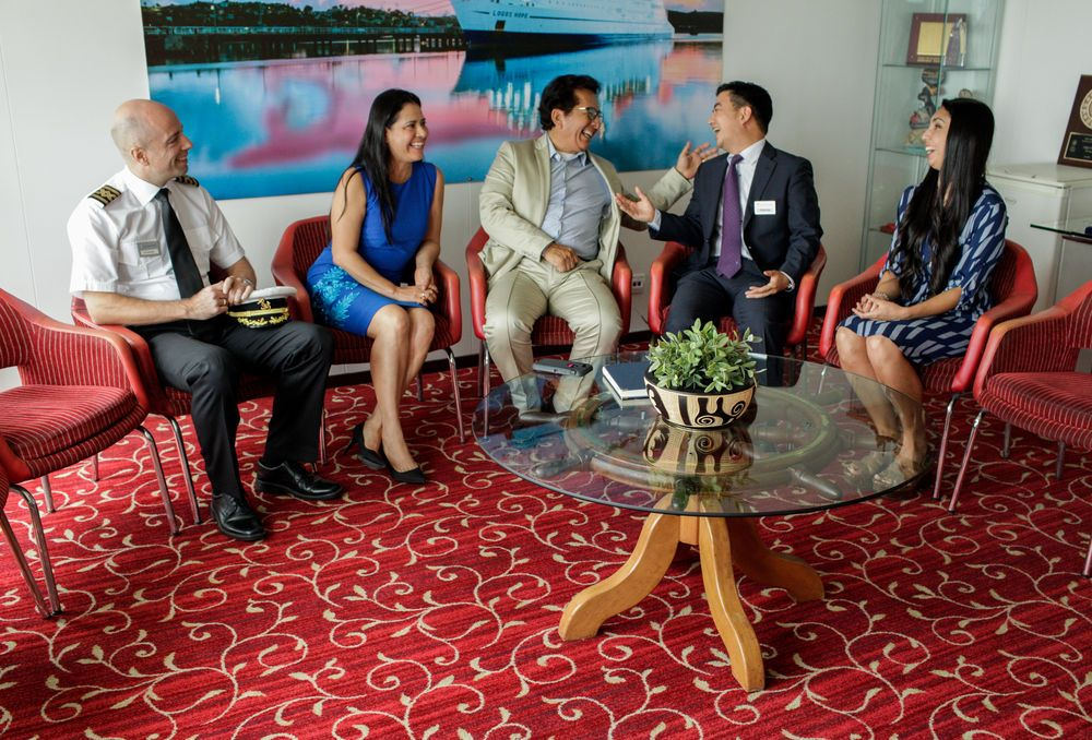 Ecuador: Manta, Ecuador :: Captain Jon Helmsdal (Faroe Islands), Director Pil-Hun Park (South Korea) and Karen Toro Parra (Chile) connect with the Governor of Manabi Xavier Santos and his guest during the official opening of Logos Hope in port. More Info