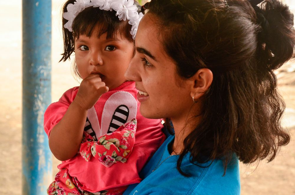 Ecuador: Manta, Ecuador :: Ailin Longo (Argentina) holds a young girl during a kids programme led by a team from Logos Hope. More Info