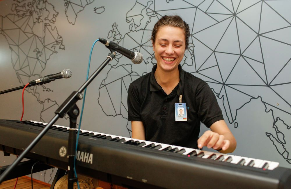 Ecuador: Manta, Ecuador :: Annika Waeldin (Germany) plays the piano on Logos Hopes experience deck. More Info