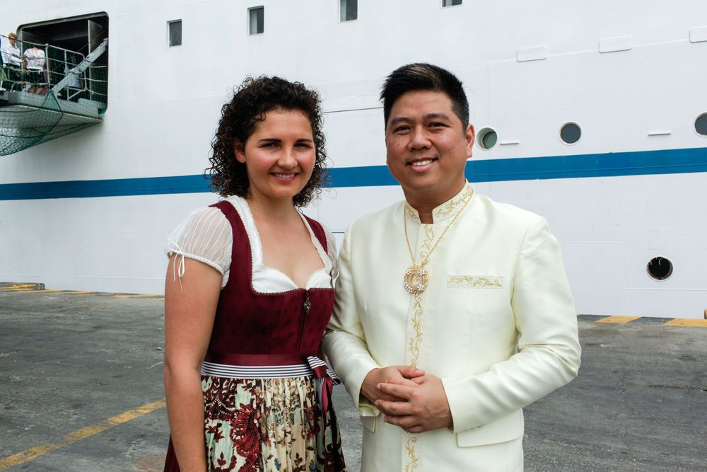 Ecuador: Manta, Ecuador :: Anita Pomp (Germany) and Boaz Pathsuthichote (Thailand) welcome visitors on board Logos Hope dressed in their national costumes. More Info