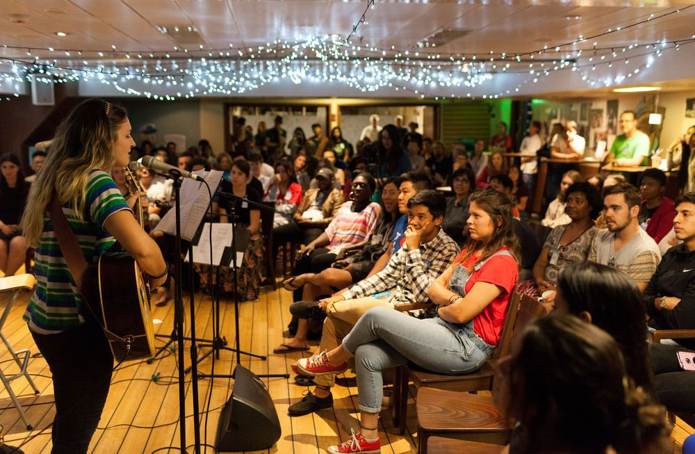 Ecuador: Manta, Ecuador :: Crewmembers including Melisa Balliu (Albania) perform their own original songs at a singer songwriter night. More Info