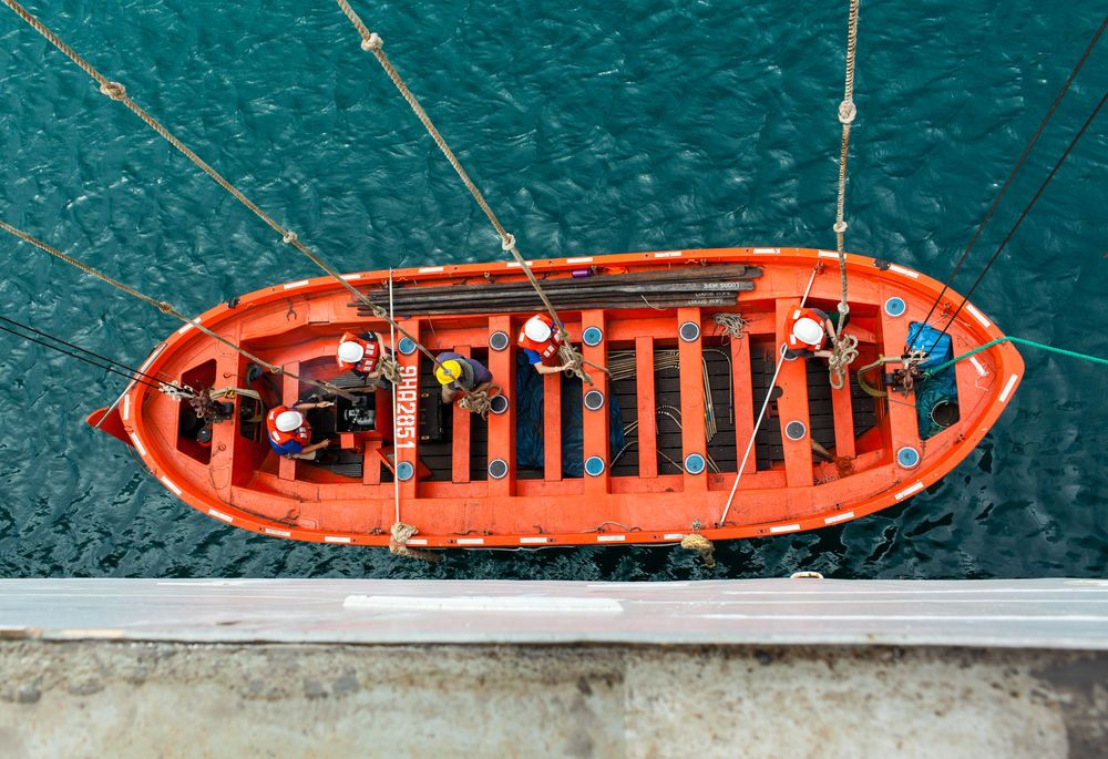 Ecuador: Manta, Ecuador :: Crewmembers lower a lifeboat into the water as part of a safety drill. More Info