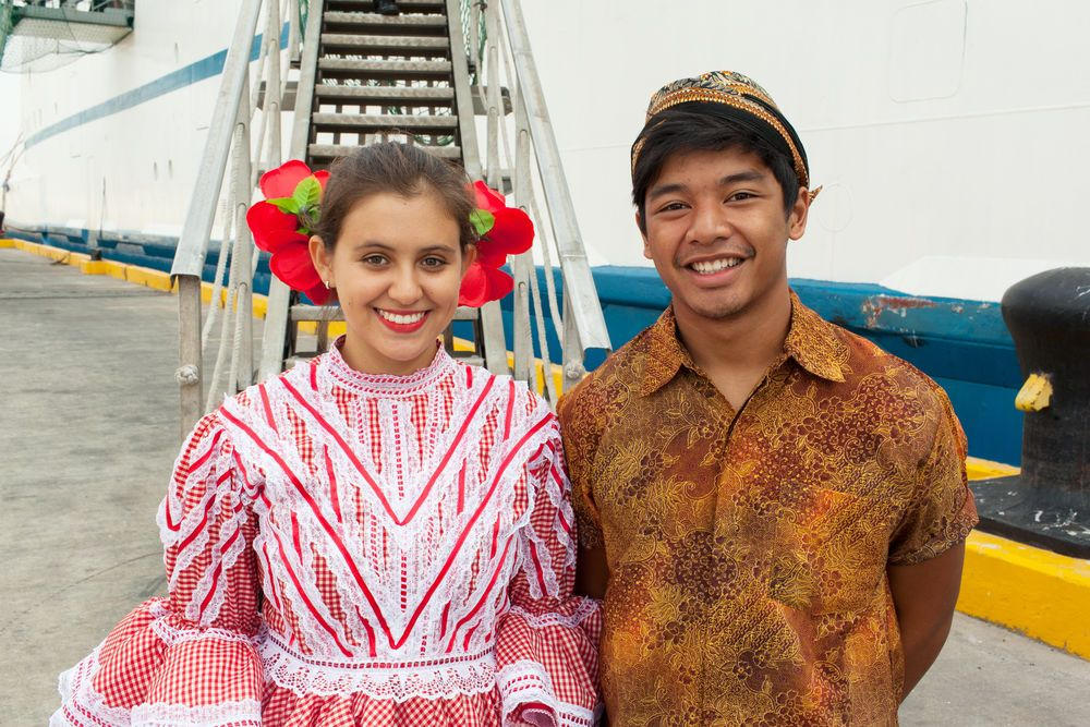 Ecuador: Guayaquil, Ecuador :: Juliana Medina (Colombia) and Michael Bukit (Canada) wear their national costumes during the official opening of Logos Hope in port. More Info