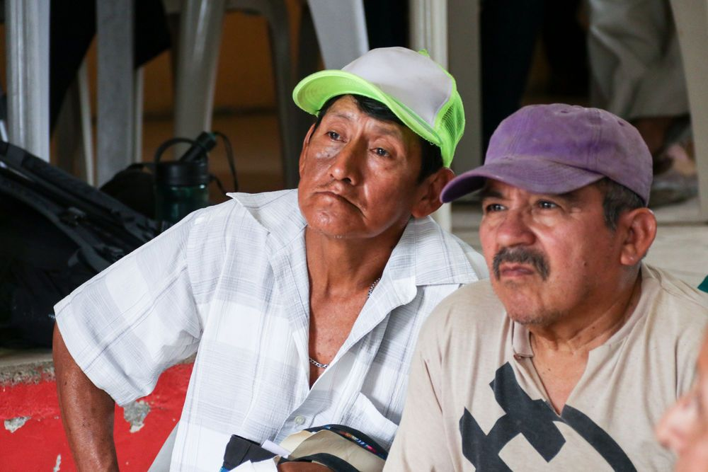 Ecuador: Guayaquil, Ecuador :: Two men listen intently to a presentation done by a team from Logos Hope. More Info