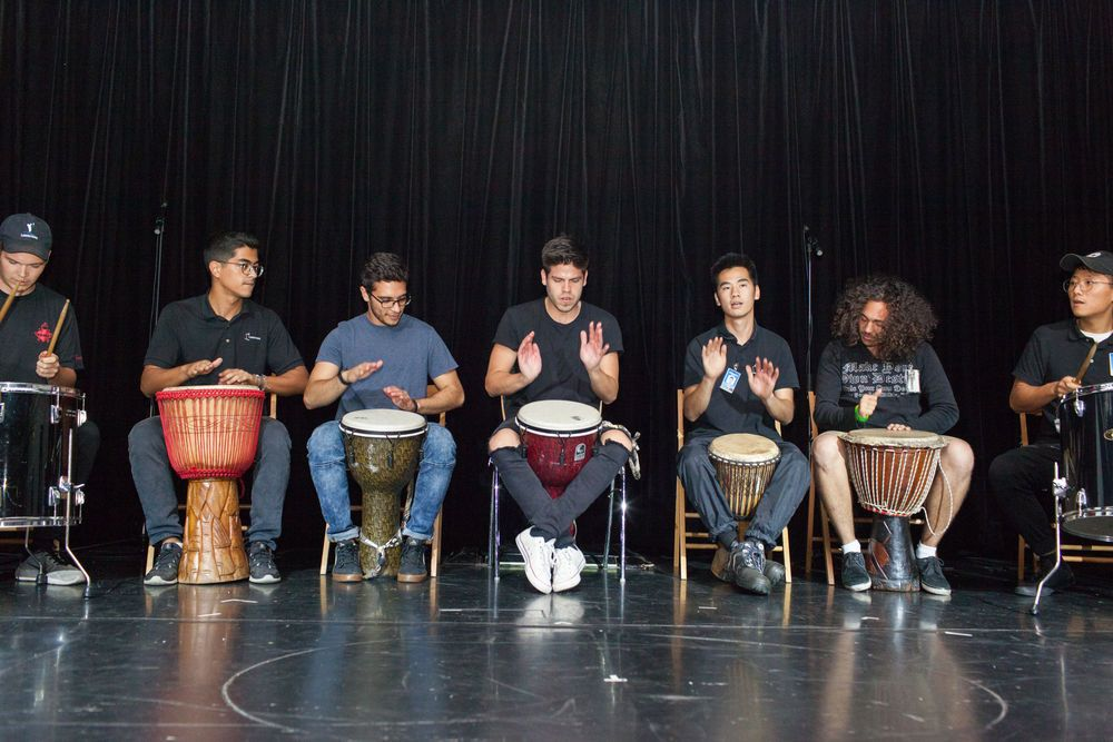 Ecuador: Guayaquil, Ecuador :: Andrin Zurbuchen (Switzerland), Caio Konichi (Brazil), Fernando Rojas Vertiz (Mexico), Ruben Muñoz (Mexico), Erdenebold Bold (Mongolia), Heber Marcos (Brazil) and Jake Lee (South Korea) performa drum routine at an onboard event. More Info