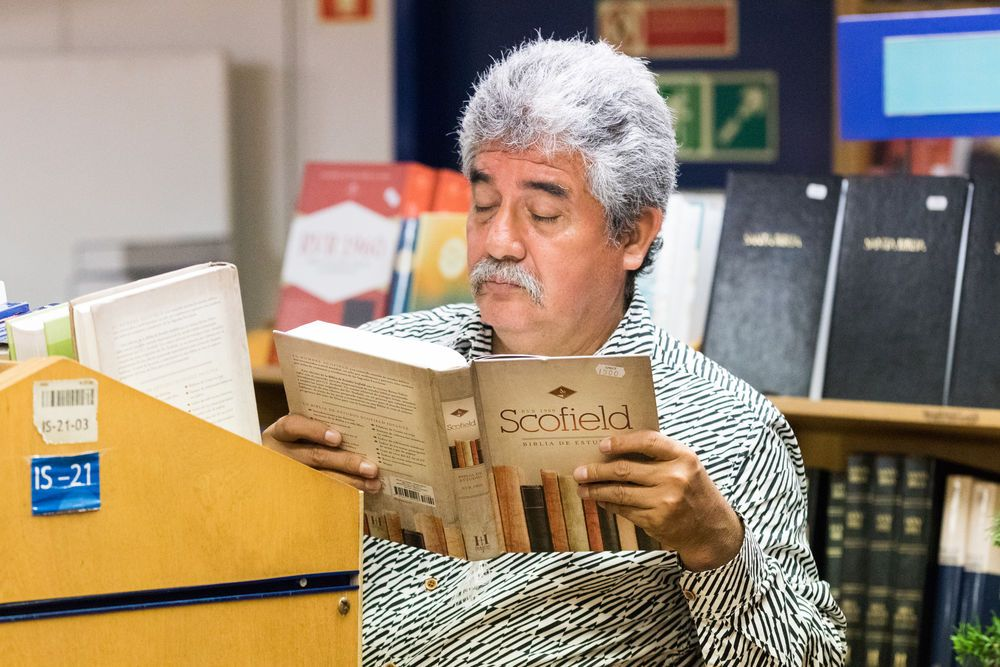 Ecuador: Guayaquil, Ecuador :: A visitor browses books during his visit to the bookfair on board Logos Hope. More Info