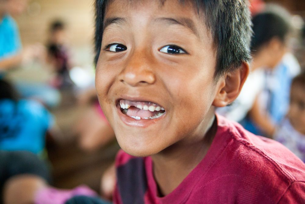 Ecuador: Guayaquil, Ecuador :: A young boy smiles during a kids program. More Info