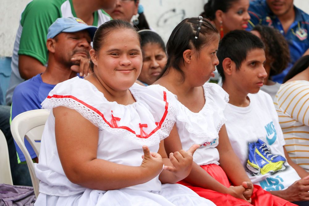 Ecuador: Guayaquil, Ecuador :: A young girl with disabilities smiles as a team from the Logos Hope shares a message of hope. More Info