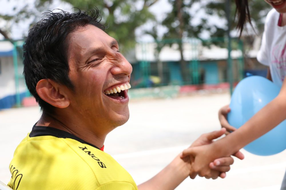 Ecuador: Guayaquil, Ecuador :: A man with disabilities laughs with joy. More Info