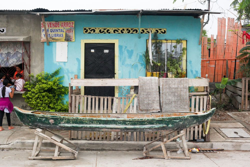 Ecuador: Guayaquil, Ecuador :: A family store their fishing boat outside outside their home. More Info