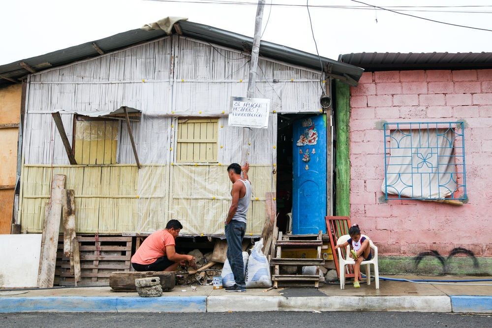 Ecuador: Guayaquil, Ecuador :: A man repairs the foundations of his home. More Info