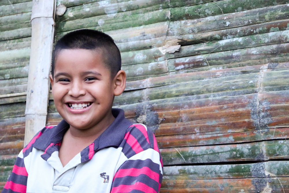 Ecuador: Guayaquil, Ecuador :: A young boy smiles outside a community shelter built by crewmembers from Logos Hope. More Info