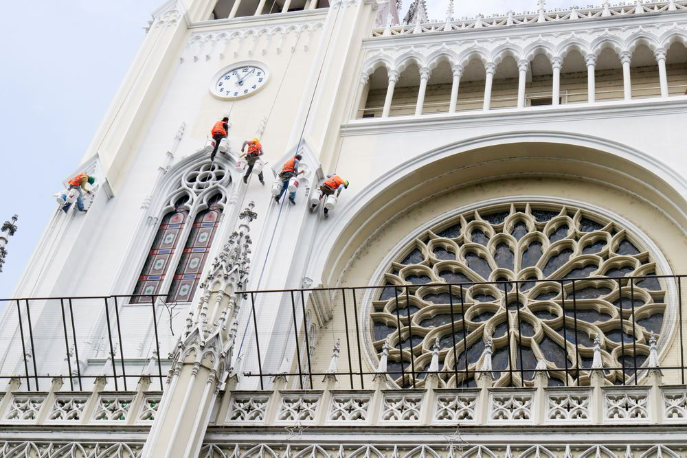 Ecuador: Guayaquil, Ecuador :: Workmen paint the outside of the Catedral Metropolitana de Guayaquil. More Info
