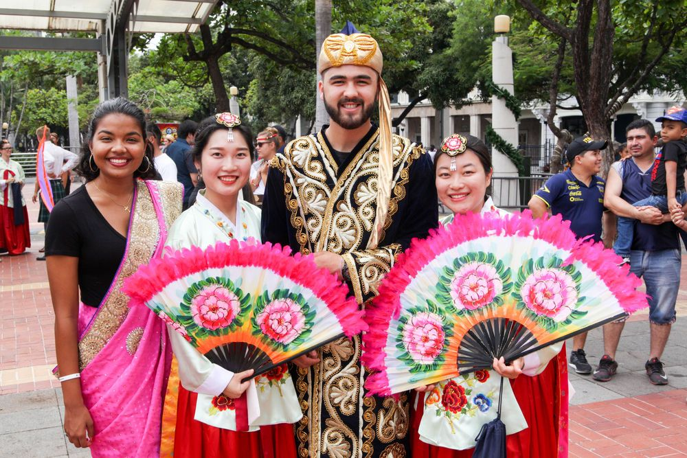 Ecuador: Guayaquil, Ecuador :: Erica Thakurdin (Barbados), Cindy Kim (South Korea), Otabek Kazykhodzhaev (West and Central Asia) and HyeMin Song (South Korea) wear their national costumes during an open air cultural event. More Info