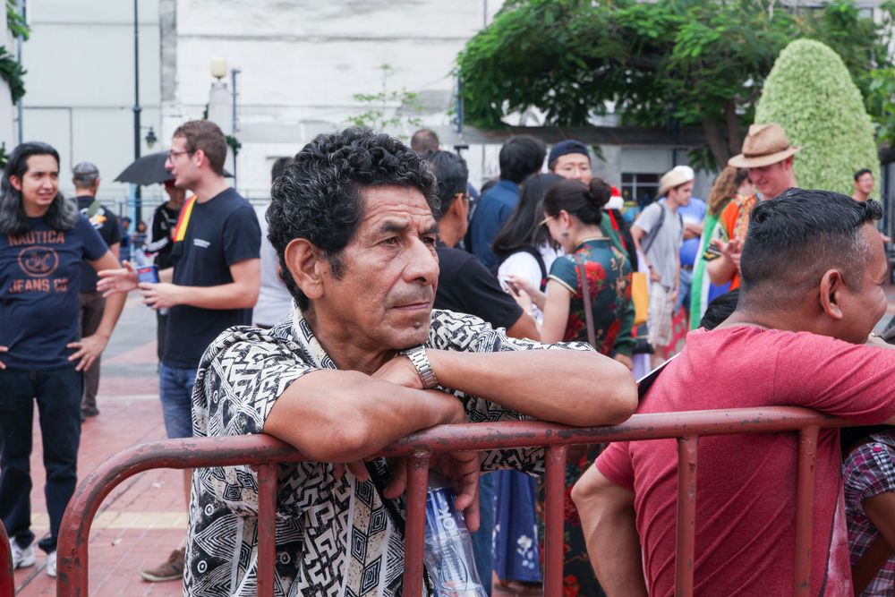 Ecuador: Guayaquil, Ecuador :: A man watches an open air cultural event held by crewmembers from Logos Hope. More Info
