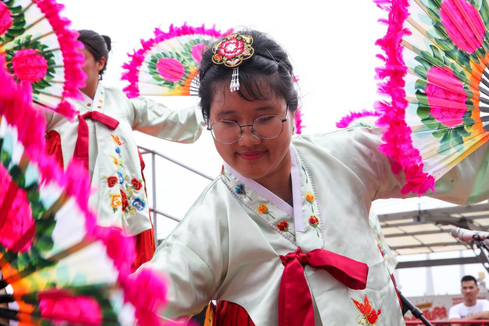 Ecuador: Guayaquil, Ecuador :: Ezra Kim (South Korea) performs a traditional Korean dance at an open air cultural event. More Info