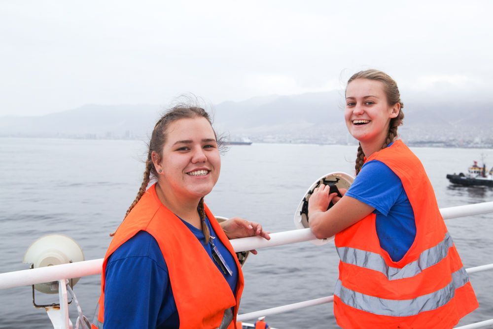 Chile: Antofagasta, Chile :: Deck crew Bianca Kotze (South Africa) and Lauren Wotherspoon (South Africa) prepare for the arrival of Logos Hope in port. More Info