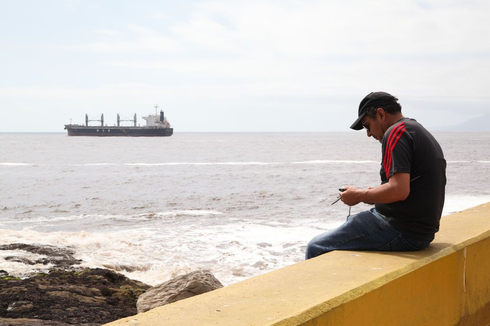 Chile: Antofagasta, Chile :: A man relaxes on the coast of Antofagasta. More Info