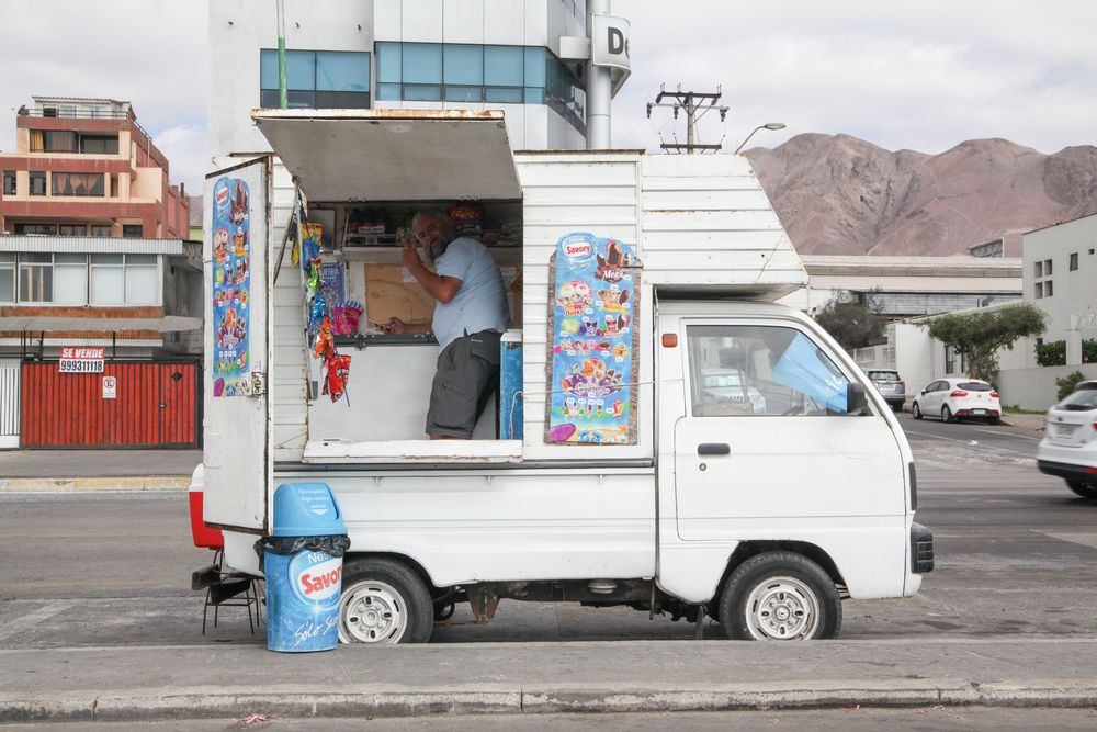 Chile: Antofagasta, Chile :: Man sells ice-cream on the side of the road from his truck. More Info