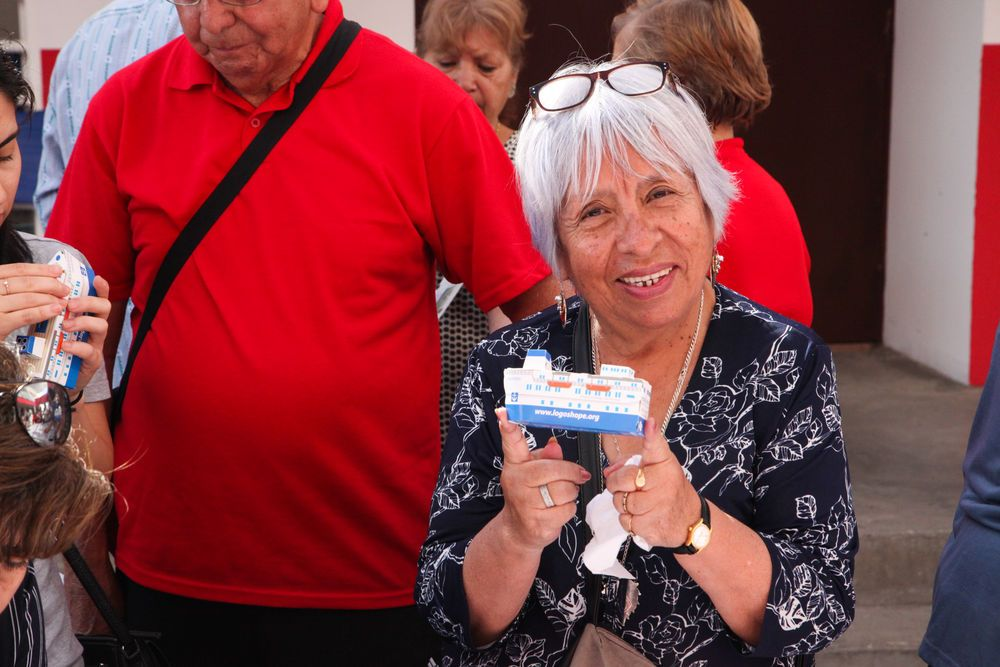 Chile: Antofagasta, Chile :: A woman smiles after completing a model of Logos Hope. More Info