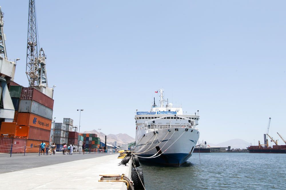Chile: Antofagasta, Chile :: Surrounded by containers, cranes and mountains, Logos Hope sits in port. More Info