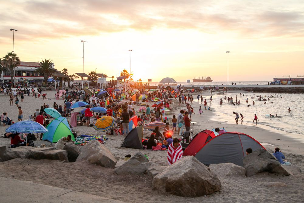 Chile: Antofagasta, Chile :: Families relax on the beachfront as the sun sets. More Info