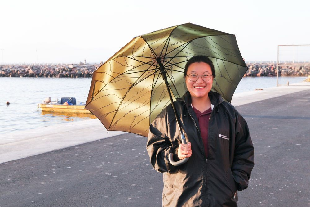Chile: Antofagasta, Chile :: HyeMin Song (South Korea) works on the quayside of Logos Hope, welcoming visitors as they arrive. More Info