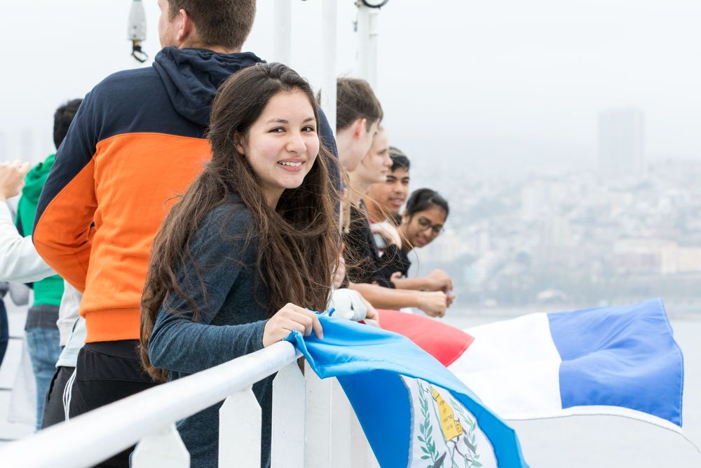 Chile: Valparaiso, Chile :: Sara Stahl (Guatemala) waves her flag as Logos Hope arrives in port. More Info
