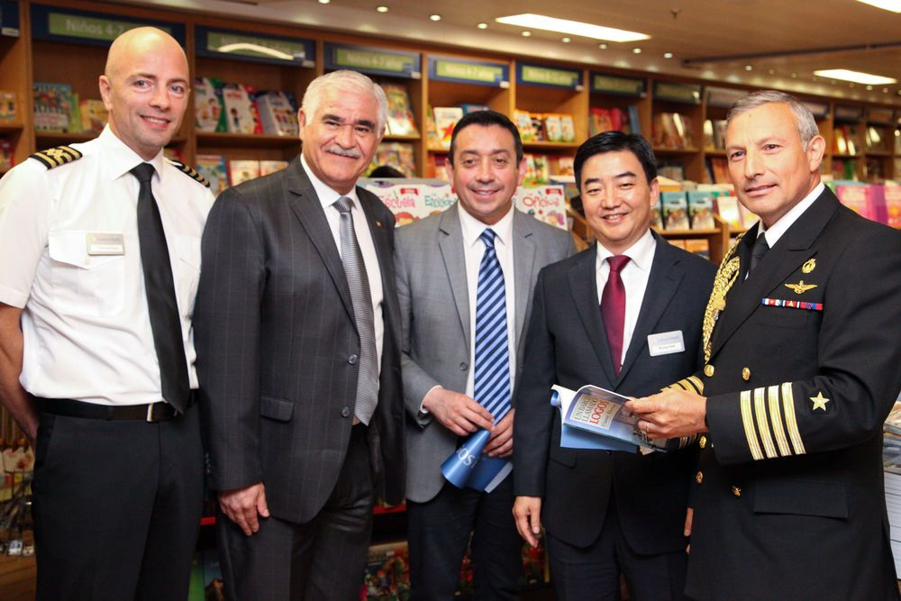 Chile: Valparaiso, Chile :: Captain Jon Helmsdal (Faroe Islands) and Director Pil-Hun Park (South Korea) give the guests of honor a tour of the bookfair during the official opening of Logos Hope in port. More Info