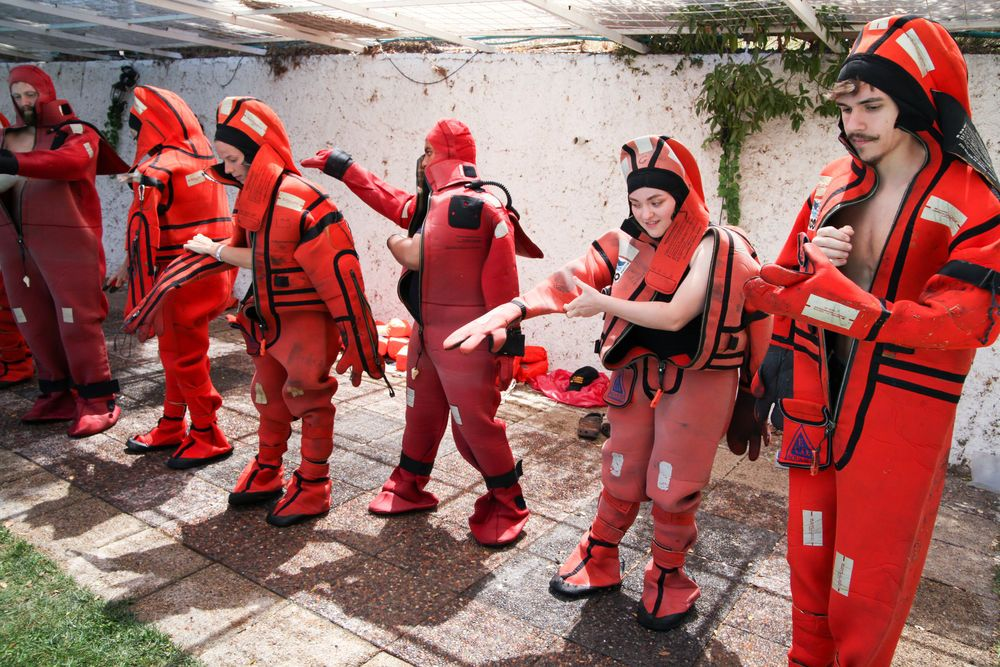 Chile: Valparaiso, Chile :: New crewmembers practise putting on and using immersion suits as part of their pre-ship safety training. More Info