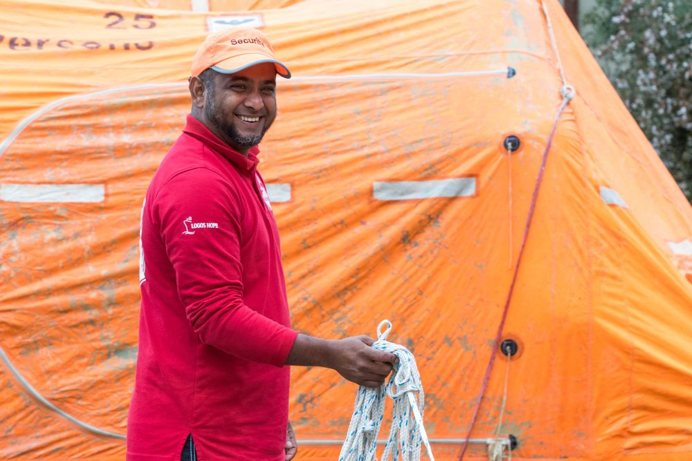 Chile: Valparaiso, Chile :: Gary Joseph (Trinidad And Tobago) trains new recruits how to use a life raft during their pre-ship safety training. More Info