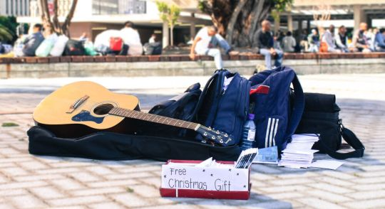 guitar on the sidewalk and free music