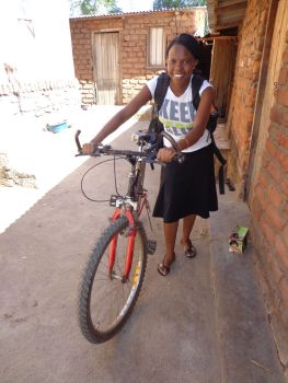 Yollanda ready to cycle to a remote village
