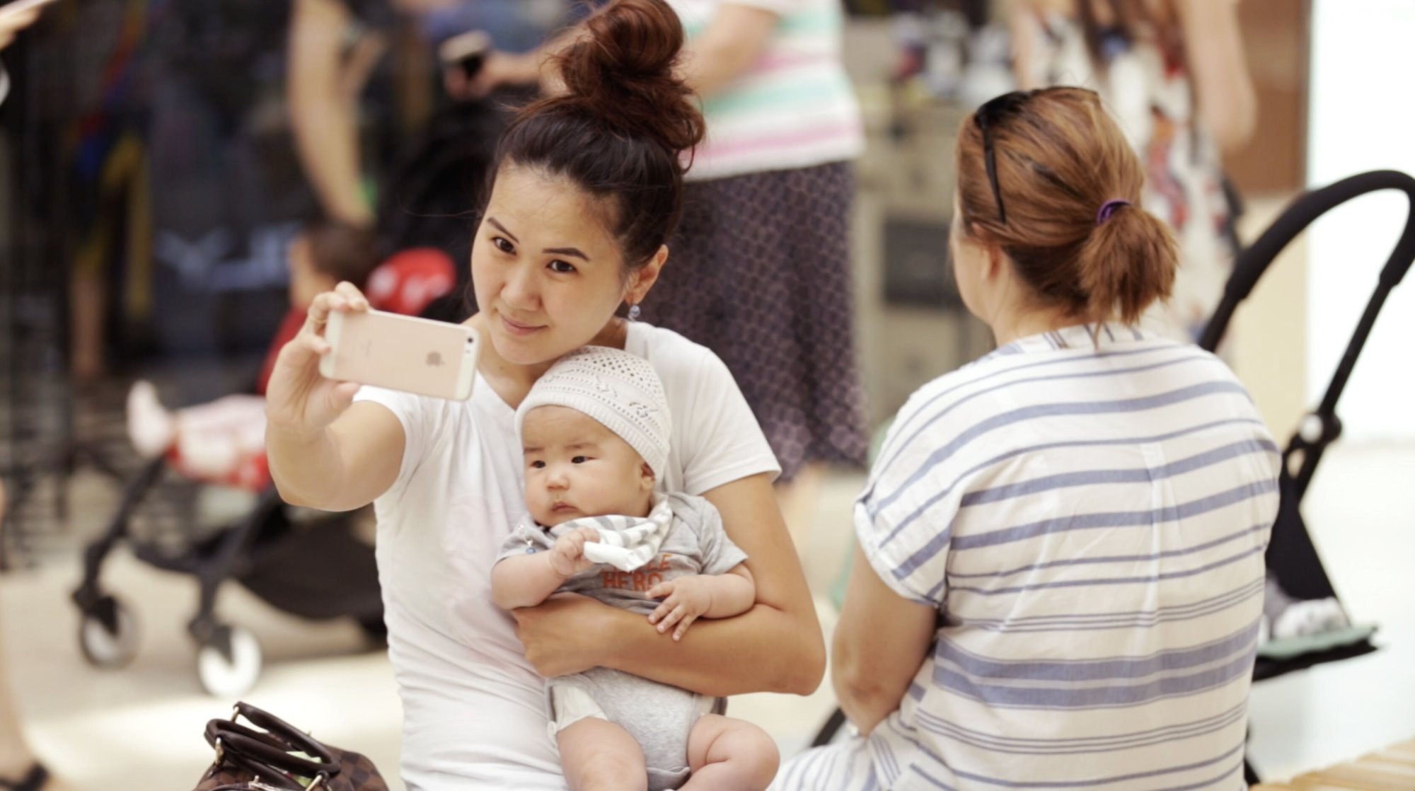 Central Asia: Technology is transforming Central Asia. A young mom snaps a selfie during a shopping trip at a local mall. Photo by Jay More Info