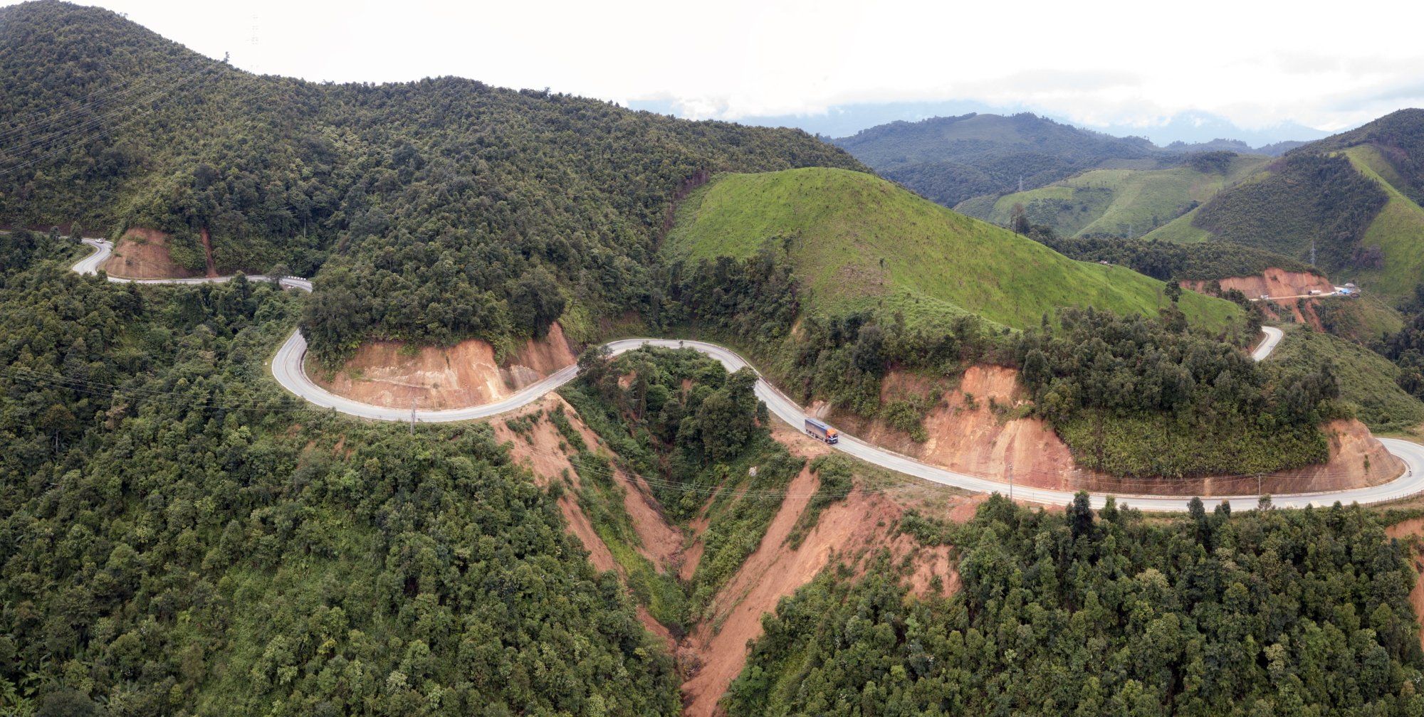 Laos: While this mudslide has been cleared, hundreds of mudslides cover roads in Laos, making many villages inaccessible. More Info