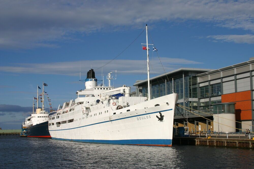 MV Doulos berthed in front of the Royal Yacht Britannia in the Port of Leith, Edinburgh in 2004.