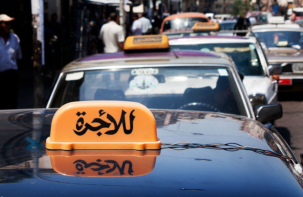 Near East: Taxi driver explains he wants to learn more about Jesus the Messiah.  Photo by Bart Broek More Info
