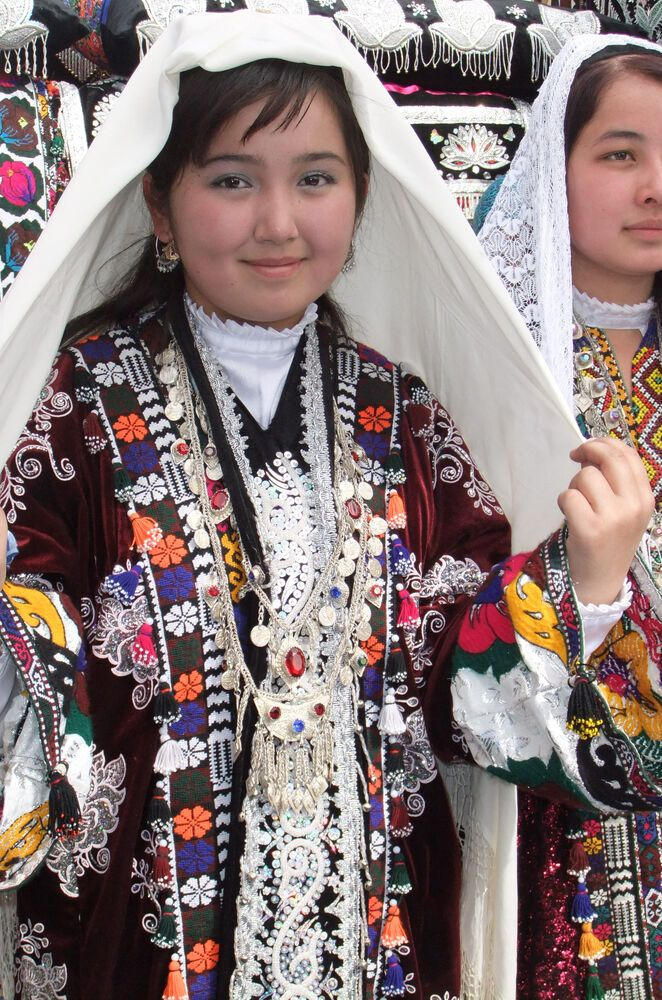 Central Asia: Young Tajik woman in traditional attire for the spring festival More Info