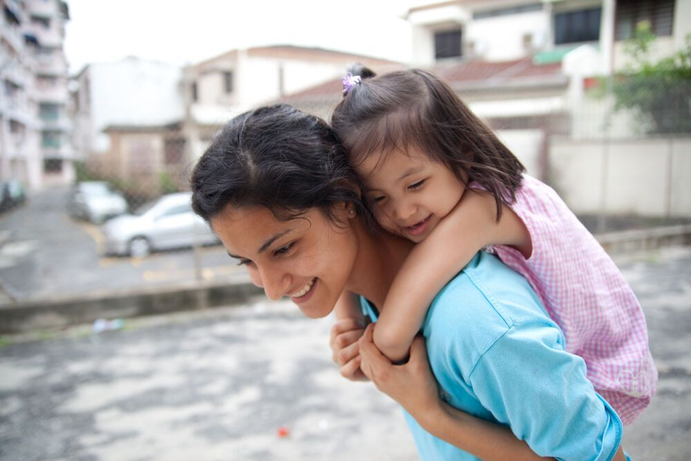 Malaysia: Penang, Malaysia :: Tarissa Correa (Brazil) carries a little girl at the House of Hope drop in centre. More Info