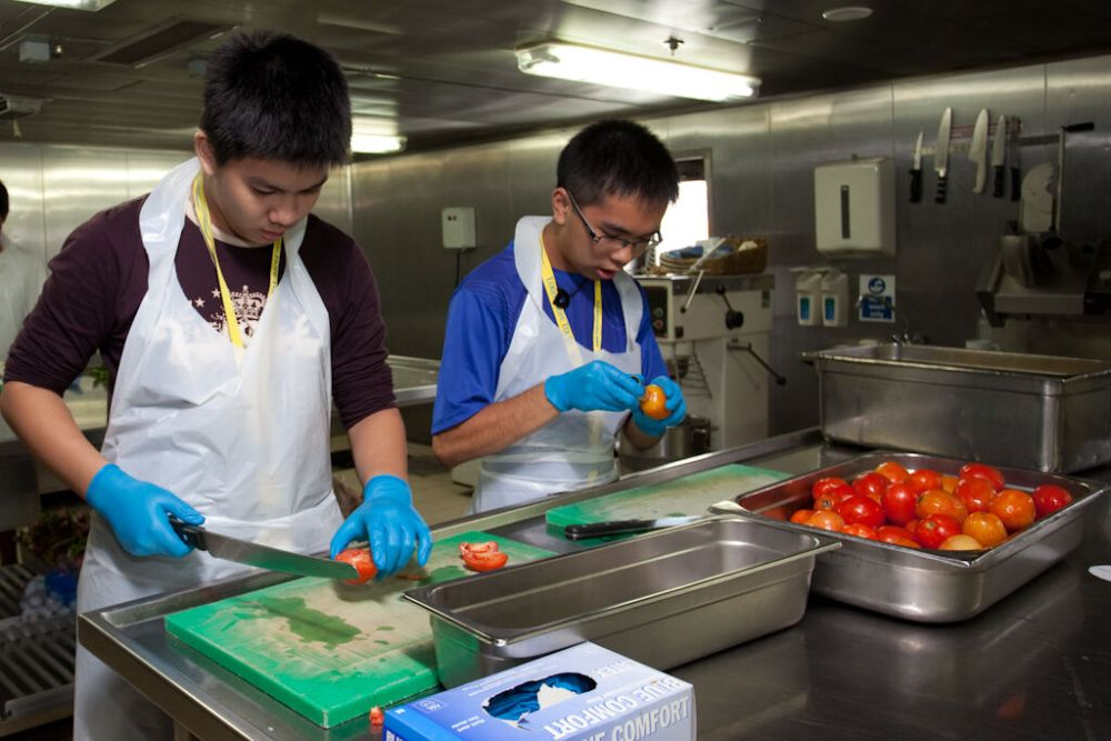 Penang, Malaysia :: Young people from the Brand New Me event  help at the galley.