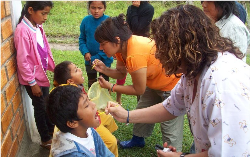 Children receive teeth treatment during outreach in the Amazon jungle in Peru.