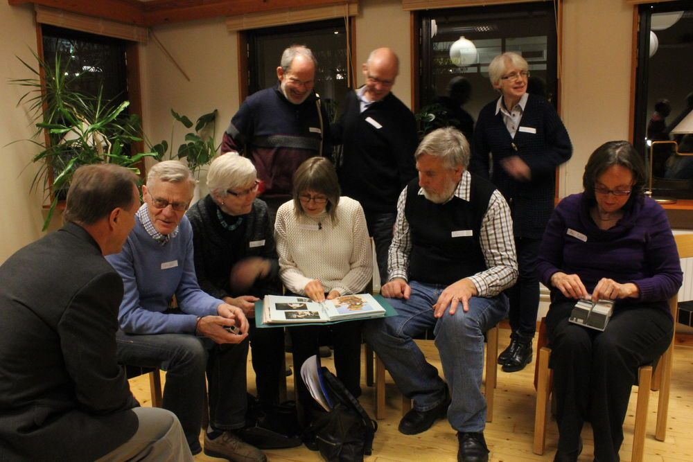 Sweden: Previous crew from the first decade of OM Ships ministry chatting and interacting over photo albums. More Info